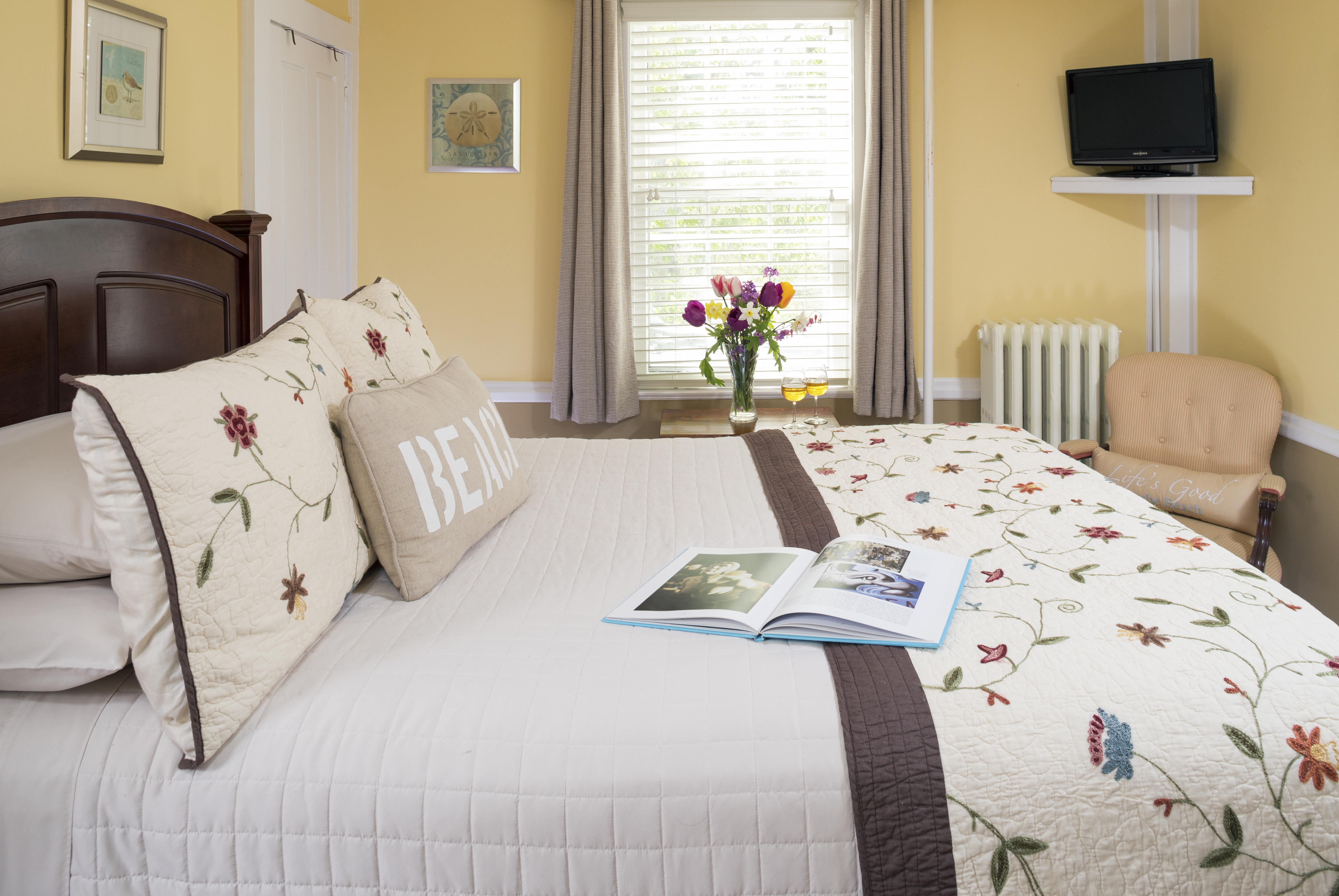 Nauset Light bed with book and flowers