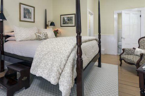 Three Sisters Light room with four poster bed and light, airy decor